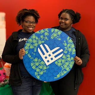 Image of two female students during the #GivingTuesday Challenge at Roosevelt University