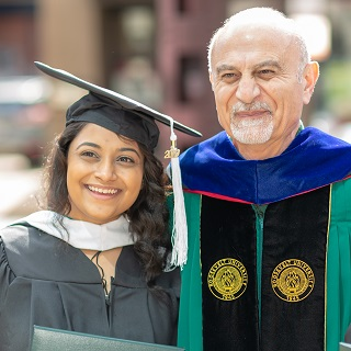 Image of a student with President Ali R. Malekzadeh, PhD at Commencement